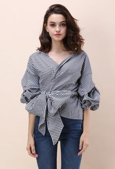 It's all in the details darling! The casually classic gingham print, dramatic bow and whimsical draping of this wrapped top make it a beautiful selection for a plethora of occasions.  - Decollete neckline - Ruche sleeves - Self-wrapped through keyhole on waist -80%Cotton,20%Polyester - Hand wash cold  Size(cm)  Length Bust Shoulder Sleeves XS         57     84    Free      44 S          57     88     Free      44 M         58    …