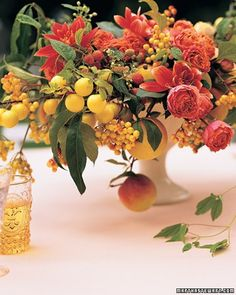 Perfect for a late summer or early autumn wedding! Shades of golden yellow, orange, and soft red. Spray roses, dahlias, with fruit such as raspberries, apples, and lemons.