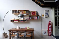 Eclectic contemporary elements in dining areaBagnolet loft.