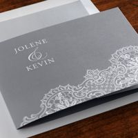 One of our most popular items, an All in One Wedding Invitation. Vintage charm with a designer touch! The lace motif on this all-in-one wedding invitation gives guests a glimpse of the elegance they can expect from the occasion, As low as $1.89 each.