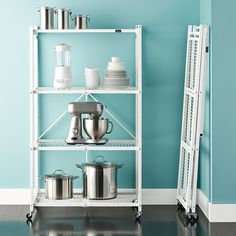 FOR BUILT LEGOS Origami 4-Shelf Folding Rack brings both a delicate aesthetic and lasting design together in one place. Constructed of steel, this piece gets its origami name from the ability to fold down for easy storage when not in use.