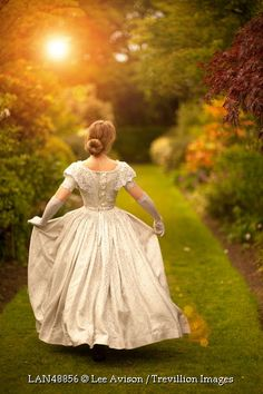 Trevillion Images - victorian-woman-running-in-sunlit-garden