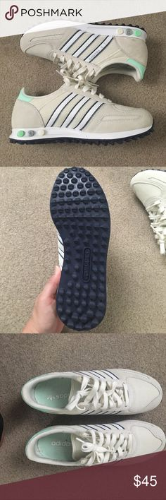 Adidas L.A. Trainer. Cream Worn once Adidas L.A. Trainer. Worn ONCE. Cream color with white stripes outlined in blue and teal heel tongue and Navy Bottoms. Last picture is price comparison not the actual shoe. adidas Shoes Athletic Shoes