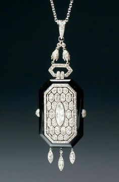Boucheron. Rare onyx and diamond pendant watch with the case made of different layers of onyx assembled by diamond set screws. The movement and dial with Roman numerals and arrow hands are hidden behind a spring mounted diamond lid of honeycomb design. Set with rose cut and round cut diamonds, mounted in platinum; Paris, circa 1920-21.