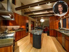 Look Inside These Gorgeous Celebrity Kitchens | OPRAH WINFREY | We bet that spacious kitchen makes for some epic dinner parties! Wonder if this is where Oprah stashed her truffles and chai tea.