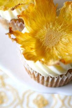 Dried pineapple flowers are a unique and eye-catching garnish that can take your cake or cupcakes up a notch.  When I first saw them I thought they must be difficult to make but in reality, they couldn't be much easier.  Essentially all you do is slice pineapple very thin and bake slowly at a low heat to dry them out.  Check it out!