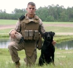 Plastered across the top of Pfc. Colton Rusk's Facebook page are photographs of a black Labrador Retriever, named Eli, who always looks like he's smiling. Rusk was a dog handler who had enlisted in the Marines right out of high school and Eli, the four-year-old bomb-sniffing dog, was his partner.    The pair was serving in Afghanistan when Rusk was hit by Taliban sniper fire on Dec. 6, 2010. Eli was the first to reach him where Rusk fell. The dog crawled on top of Rusk's body,  ferociously p...