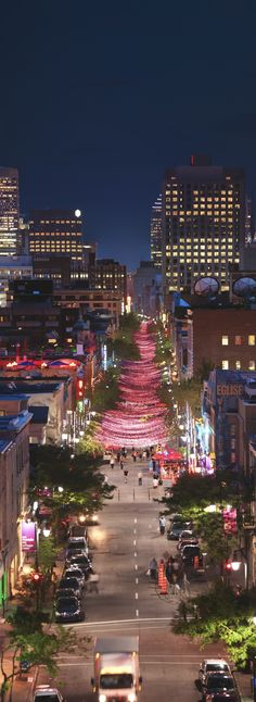 Suspended Pink Ball Ribbon Installment Over St. Catherine Street In Montreal