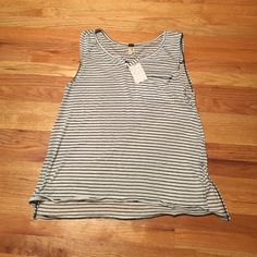 NWT, Free People Black & White Striped Sleeveless Brand new never worn, polyester and cotton material, black and white striped with a pocket and slits on each side if the top.  Authentic, very cute top Free People Tops Blouses