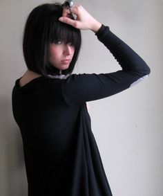 Still Waiting  Black asymmetrical sweater with elbow by Minxshop. Love this shop, but I really want her hair! Color and cut.