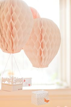 DIY tutorial for making these hot air balloons. Comes for a Flight of Fancy Mother's Day brunch party.