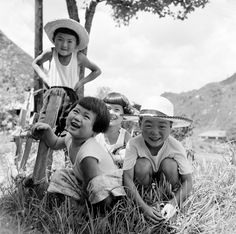 https://flic.kr/p/pD1tdr | Children in Hats Smiling - 1950s Japan | A group of children having fun in the grass - and the boys wearing hats. A photo of life in Japan in the 1950s. I'm not sure of the exact date of this photo, but it is from a group of found negatives where some pictures are marked 1955.