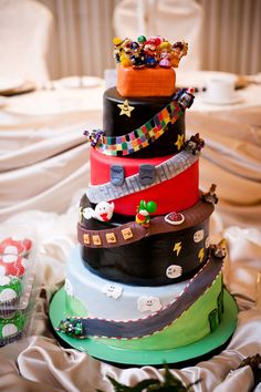 Mario Kart Wedding Cake - I don't know if I would want it as my wedding cake but I would totally want it as a birthday cake!! #Nintendo #MarioKart #Cake