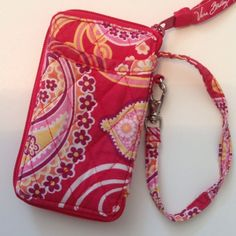 Vera Bradley Phonecase Wallet Wrist let strap, phone pocket, ID slot, zipper pocket, card slots, good condition, approx 5.5 in by 3.5 in Vera Bradley Bags Wallets