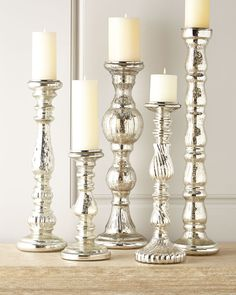 Mercury glass candle holders. Love 'em and use them all the time. We are using many with arrangements on the top for an Aug wedding