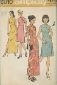An unused original ca. 1972 Simplicity Pattern 5010.  Misses' Dress in Two Lengths: The dress with high round neckline has side zipper, Mandarin collar, right front closing, and slits in side seams. V. 1 & 2 with short set-in sleeves have frog closing. V. 1 & 3 are regular length. V. 2 & 4 are ankle length. Sleeveless V. 3 & 4 with shaped right front have loop and button closing.