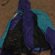 Cute Vintage Nike Windbreaker! Its in perfect condition! I'm changing up my style so I dont really want it anymore. I got it from a store for 55! Really stylish :-) Nike Jackets & Coats