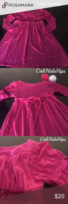 Fuschia girls long sleeve with sequins dress A little bit of sparkle for a cute little girl. This dress has soft fabric with a bit of stretch made of 60% polyester 32% rayon 8% spandex. Great as we are transitioning into the Fall season. Great condition! Dresses