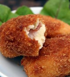 Croquetas de jamon  Spanish Cured ham Croquetas   These are a big favorite tapa or snack in spain.  I used to think they had cheese in the middle til a spanish friend told me how they are made.  They can be made with chicken also or with no meat at all.  Yummy