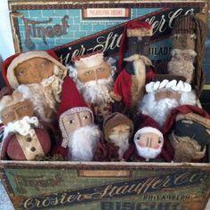 Box full of wonderful prim Santas.