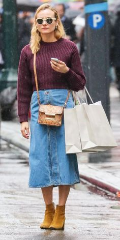 8 Celebrity Looks That Prove We're Living in That '70s Show   InStyle.com Diane Kruger perfected her off-duty style in a burgundy knit and a button-front denim midiskirt that she styled with nude frames, a Jason Wu python cross-body purse, and tan booties.