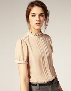 A soft, muted color blouse with feminine details, like a ruffled collar and puff sleeves, is the perfect top for or inspired looks. Check out our online boutique to see what retro tops are in stock! Look Fashion, Fashion Beauty, Womens Fashion, Spring Fashion, Mode Top, Beautiful Blouses, Latest Outfits, Mode Vintage, Mode Inspiration