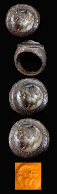 """""""A fine Indo Greek silver ring with chalcedony intaglio featuring three heads in profile (possibly royal). Circa 150 B.C."""""""