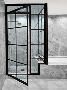 7 Breathtaking Bathrooms | Projects | Interior Design--I really love the use of these windows as doors and sides of the shower enclosure! But the cleaning?? More