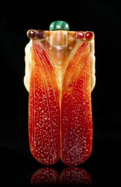 A Carved Hornbill Snuff Bottle,  in the form of a cicada having carving on the underside of the legs, with malachite