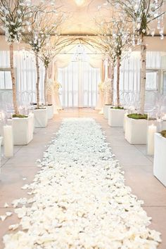 ALL WHITE EVERYTHING From rose petals to birch trees, a monochromatic color scheme nods to the season without becoming a caricature. - minus the ugly archway