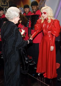 Lady Gaga Evening Dress - Lady Gaga meets the Queen in a dramatic red latex dress.