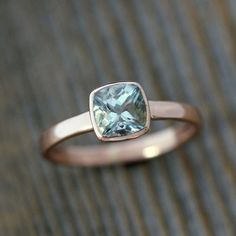 delicate and modern aquamarine engagement ring on rose gold band