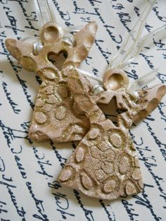 Glittery gold set of ceramic angel ornaments with heart and star cutouts tied with ribbon for hanging on your tree Ceramic Christmas Decorations, Diy Christmas Ornaments, Pottery Studio, Pottery Art, Pottery Ideas, Clay Angel, Pottery Angels, Pottery Courses, Pottery Handbuilding