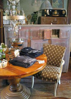 Cupboards, tables, chairs, and chandeliers oh, my! Lovely little (and big) things at Sisters Garden!