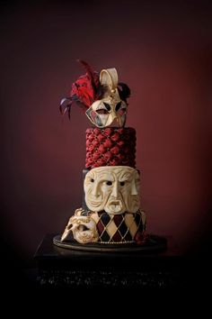 Carnevale di Venezia - This cake was inspired by the Carnival in Venice Italy.  It was featured in the CC magazine vol.3 issue 2.  Masks are made of gumpaste and hand painted.  Triple face mask is made of modelling chocolate.