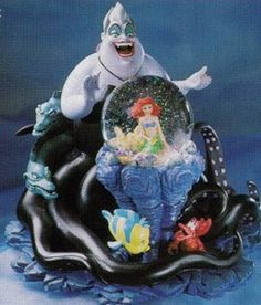 Scan from the Disney Catalog. Little Mermaid Description:  Ursula, accompanied by her evil cohorts, Flotsam and Jetsam, her fluid tentacles...