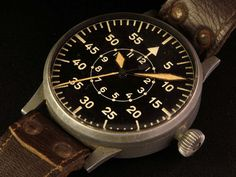 The History of the Pilot Watch Part Five: B-Uhr---B-Uhr, the offspring of Germany and Switzerland's leading watchmakers, has a noted history of design and production, but was employed for an infamous cause. The B-Uhren watches guided German bombers in their terrible campaigns of World War II with dropped bombs whistling through air to end in devastating consequence.