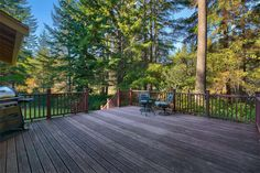 Giant-sized deck facing out at the beauty of the trees and natural wetlands!