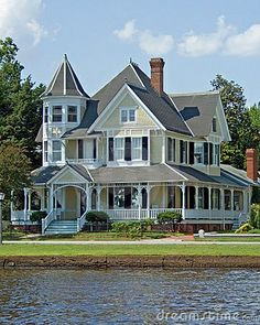 Dream Home... Victorian home, bay window, and wrap around porch.  A girl can dream considering that I'll be lucky if I can afford a oversized cardboard box one day.