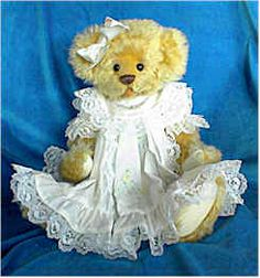 """Diana by Donna Hager  16"""" bear made of pale gold distressed mohair, wearing white dress trimmed in lace, white cotton bloomers and satin hair bow!"""