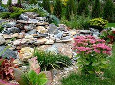rocks garden with blooming plants http://www.lushome.com/rock-garden-design-tips-15-rocks-garden-landscape-ideas/76475