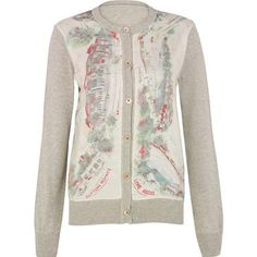 This classic cardigan has been livened up with a stylish silk panel insert, which features our beautiful Seaside print.  A truly versatile style that can be dressed up or down.