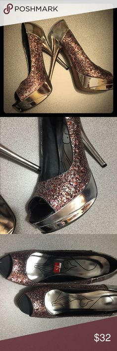 Baby phat shoes Baby phat shoes beautiful glittery multi color  size 7.5 stilettos, they are store Display last pair I have Baby Phat Shoes Platforms