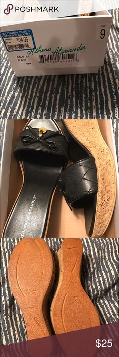 Wedge cork sandals Never worn. Still in original box with gift receipt. Athena Alexander. Size 9. Cork bottom, rubber duke, black leather stitched top. Very pretty, just not my style. athena alexander Shoes Sandals