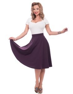 Flutter around like Lucille Ball in this flirty skirt. Made with stretchy draping fabric, it's one of those basic circle skirts every good retro aficionado should have! Universally flattering with its cut and fabric, it can really fit anybody. For those worried about length, throw on a pair of heels! Not only will you get the desired length, you'll instantly glam up your look. No matter what your height, this skirt looks fabulous even with a pair of cute flats! You'll just want to twi...
