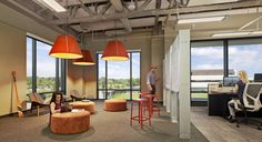 We spy Carl Hansen & Son Shell Chairs at TripAdvisor's Needham headquarters.