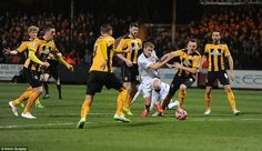 Manchester United striker James Wilson runs into trouble and finds himself outnumbered by Cambridge United defenders