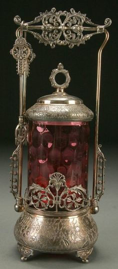 Lot: 1329: A GOOD CRANBERRY PICKLE CASTOR circa 1900, cylind, Lot Number: 1329, Starting Bid: $400, Auctioneer: Jackson's Auction, Auction: American & European Fine Art and Antiques, Date: June 15th, 2006 EDT