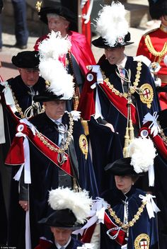 The Order of the Garter is the senior and oldest British Order of Chivalry, founded by Edward III in 1348. The Garter ceremonial dates from 1948, when formal installation was revived by King George VI for the first time since 1805. Pictured, the royals marching through Windsor ahead of the ceremony