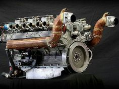 Lamborghini V12, looks like water cooled exhaust manifolds and a front water pump for a boat. Too sweet!!